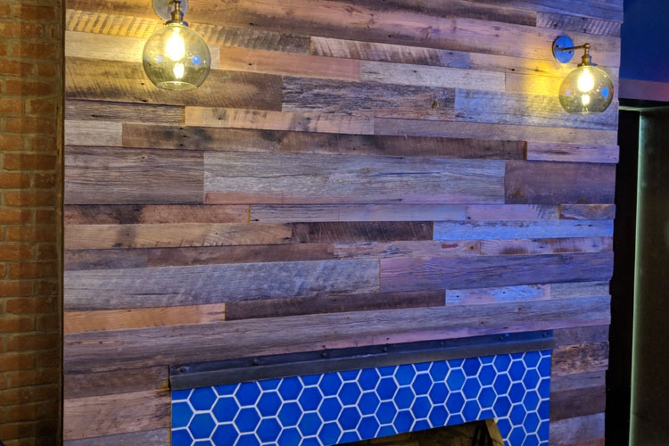 Bar Area: Reclaimed barnwood fireplace accent wall