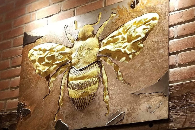 Upstairs Dining Room: Mixed-media Bee artwork over fireplace