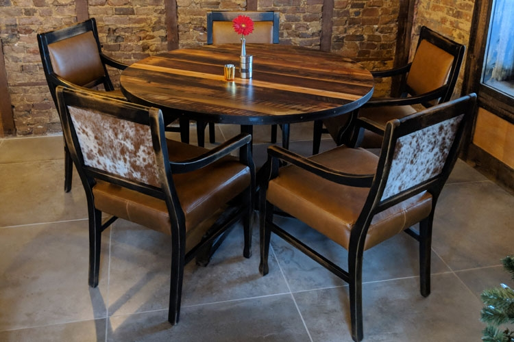 Downstairs & Upstairs Dining Rooms: Reclaimed Barnwood & Steel Tables, Distressed chairs with leather-look vinyl seats and hair-on-hide leather backs