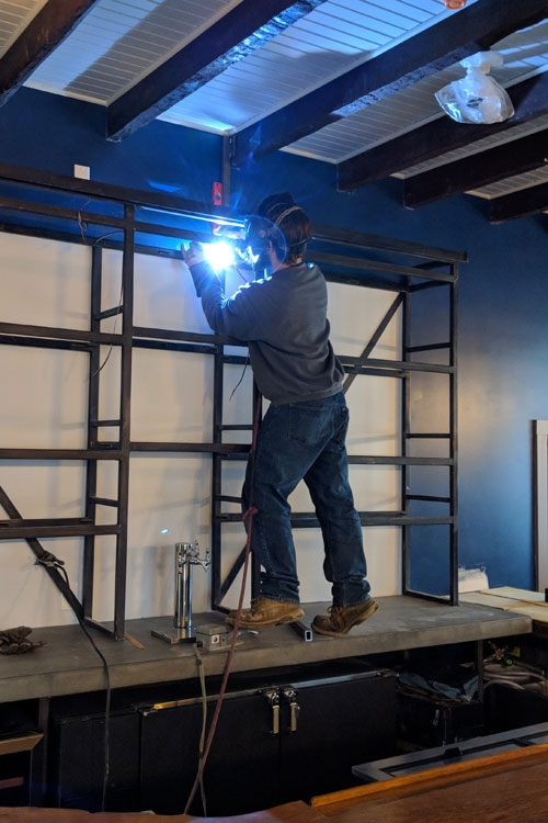 Bar Area: Kevin Woods welding the custom steel back bar